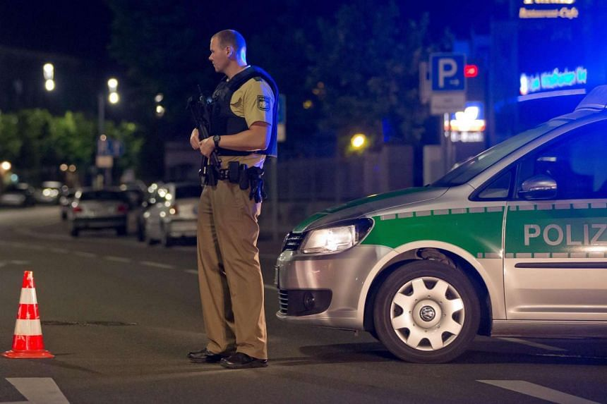 A policeman with a machine gun stands guards in Ansbach, Germany, July 25. One person was killed and 10 others were injured in an explosion in Franconia Ansbach late on July 24.