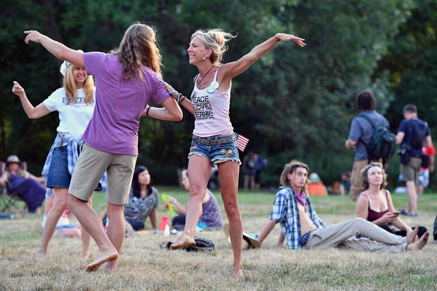Bernie Sanders' supporters dance to music in Franklin Delano Roosevelt park before the start of the Democratic National Convention on July 24, 2016.