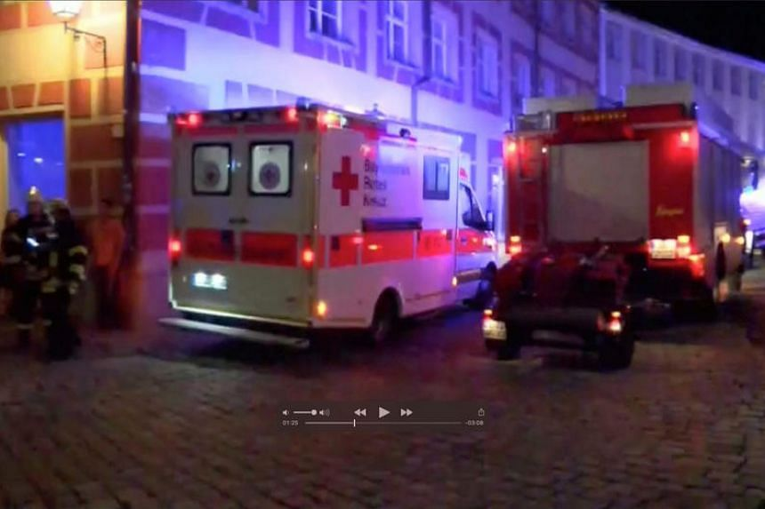 Emergency workers and vehicles are seen following an explosion in Ansbach, near Nuremberg, on July 25 in this still image taken from video.