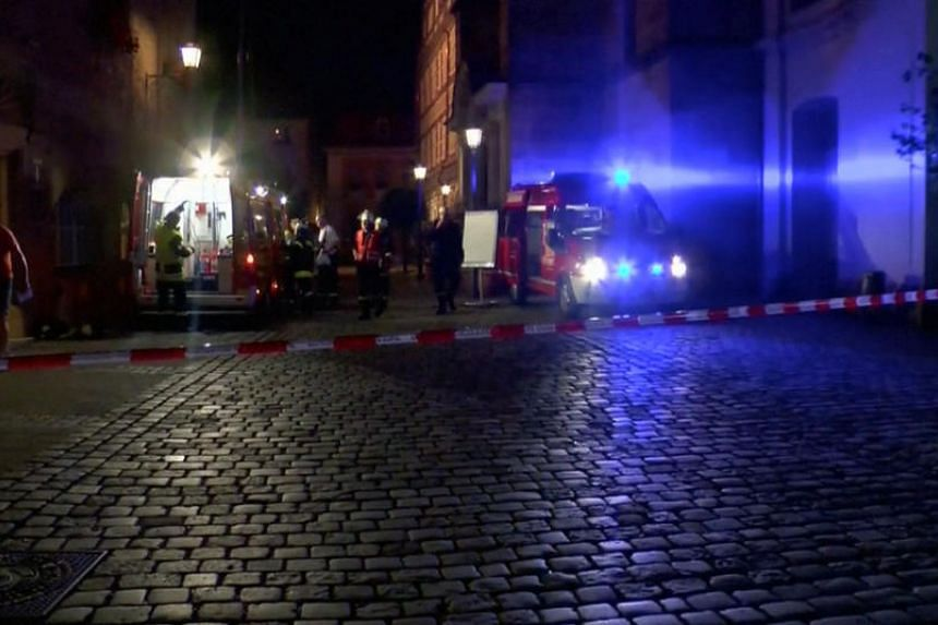 Emergency workers and vehicles are seen following an explosion in Ansbach, near Nuremberg July 25 in this still image taken from video.