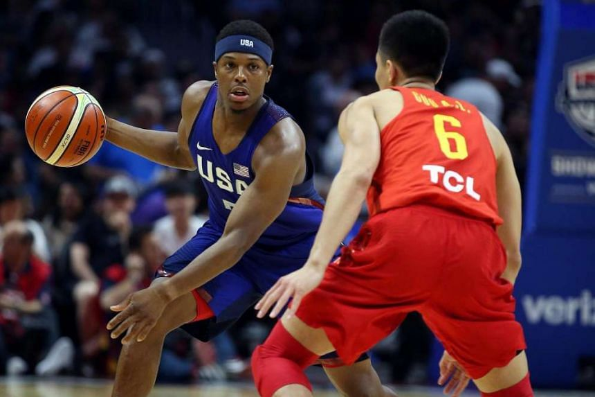 USA's Kyle Lowry (left) in action against China's Guo Ailun (right) in an exhibition game in Los Angeles, on July 24, 2016.