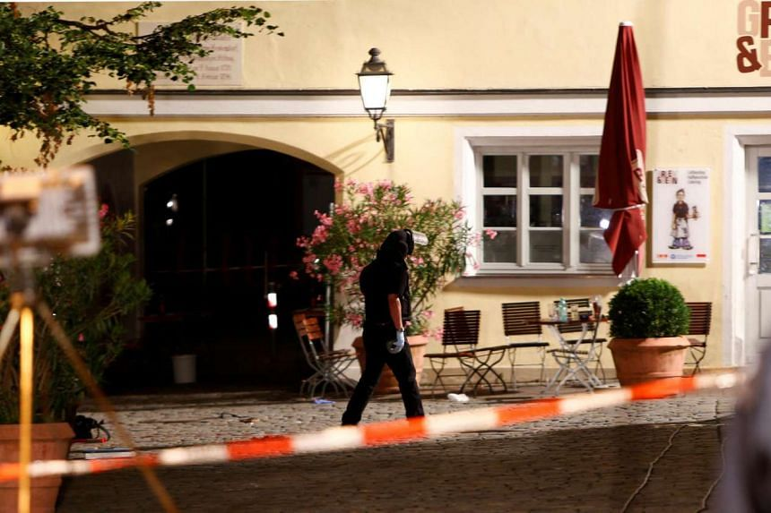 Police secure the area after an explosion in Ansbach, near Nuremberg, July 25.