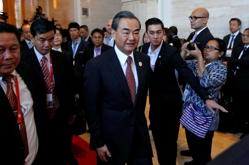 China's Foreign Minister Wang Yi arrives at a meeting at the sidelines of the Asean foreign ministers meeting in Vientiane on July 25, 2016.