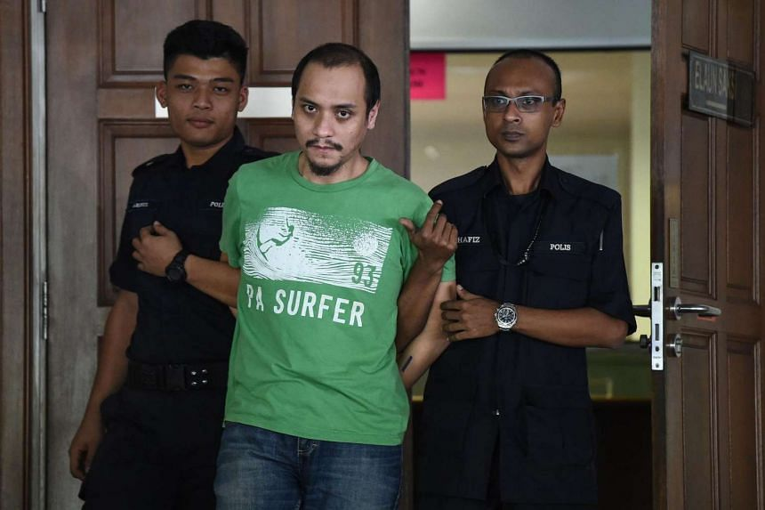 Malaysian police escort alleged militant Fazar Nor Reduan (centre) from the courthouse after being charged for terror-related activities in Kuala Lumpur, on July 25, 2016.