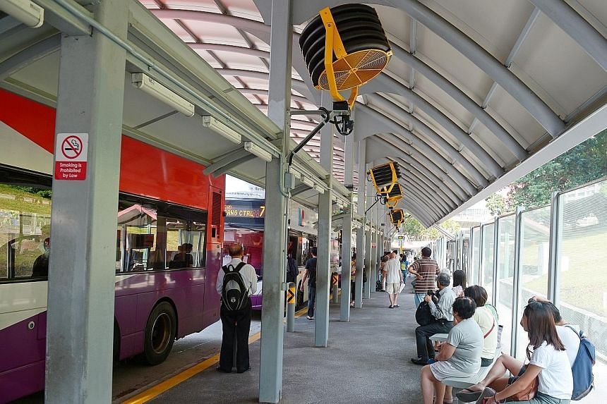 Fans on trial at an Ang Mo Kio bus stop. They can be activated using switches, and will be powered to run for 15 minutes at a time.