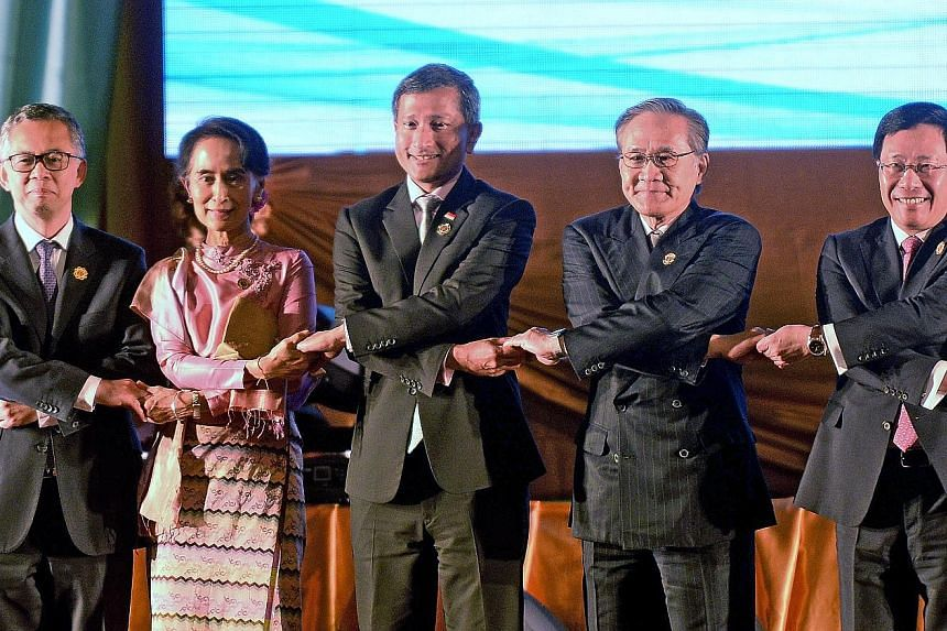 (From left) Malaysian Foreign Ministry Secretary-General Othman Hashim; Myanmar State Councillor and Foreign Minister Aung San Suu Kyi; Singapore Foreign Minister Vivian Balakrishnan; Thai Foreign Minister Don Pramudwinai; and Vietnamese Deputy Prime