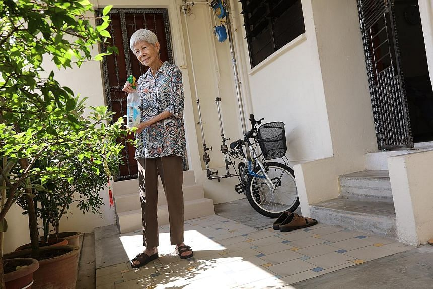 """Madam Low Sok Chin, 70, is concerned that the two steps separating her three-room HDB flat from the corridor may make it difficult to take her husband, who suffered a stroke last month, out for his medical appointments. """"It is comforting to know that"""