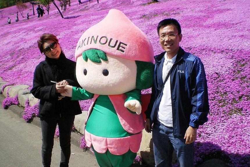 Mr Kho with his late wife, Ms Phelane Long, in a May 2010 photo taken in Hokkaido. A month before she died, Mr Kho quit his bank job to care for her round the clock. From left: Ms Tan, Prof Mahendran and Dr Lim. The latter two co-led the study of 258