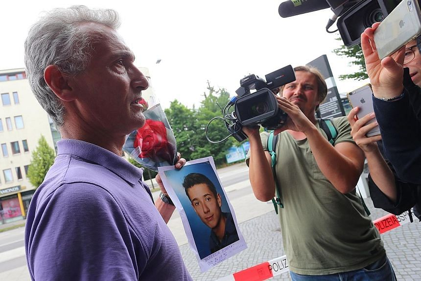 A man holding up a photo of his son killed in the shooting as he talks to reporters. During the attack, social media made it hard for police to tell apart real and false news.