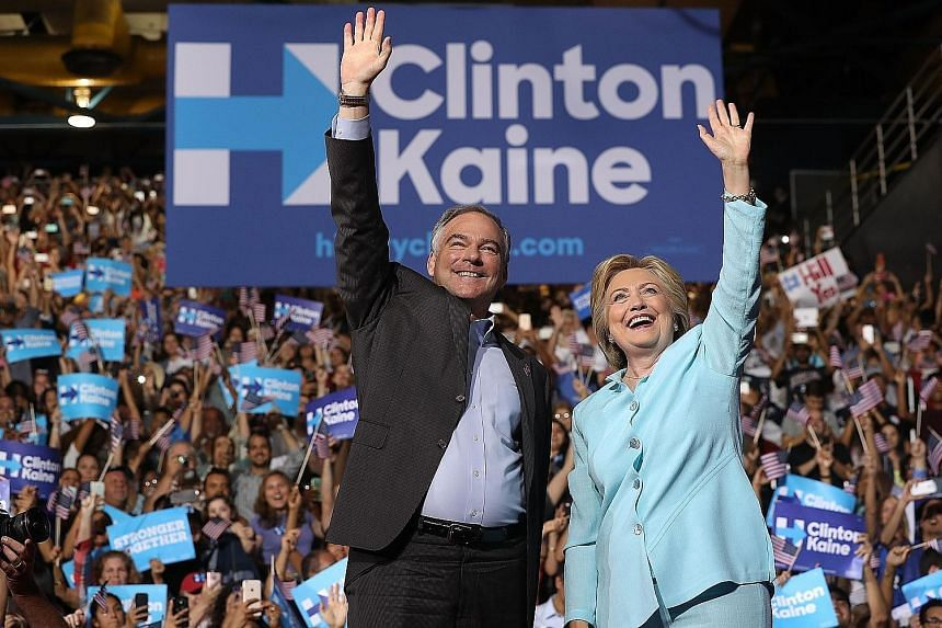 Mrs Clinton and Mr Kaine at a campaign rally in Miami, Florida, on Saturday, where the latter made his debut appearance as the Democratic presidential candidate's running mate.