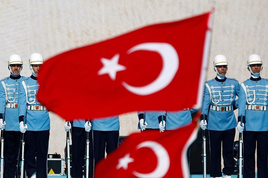 Presidential guardsmen at a rally to mark the 563rd anniversary of the conquest of Istanbul by Ottoman Turks in May this year. Of the regiment's 2,500 members, 300 were arrested over suspected links to last week's failed coup. Figures close to Mr Fet