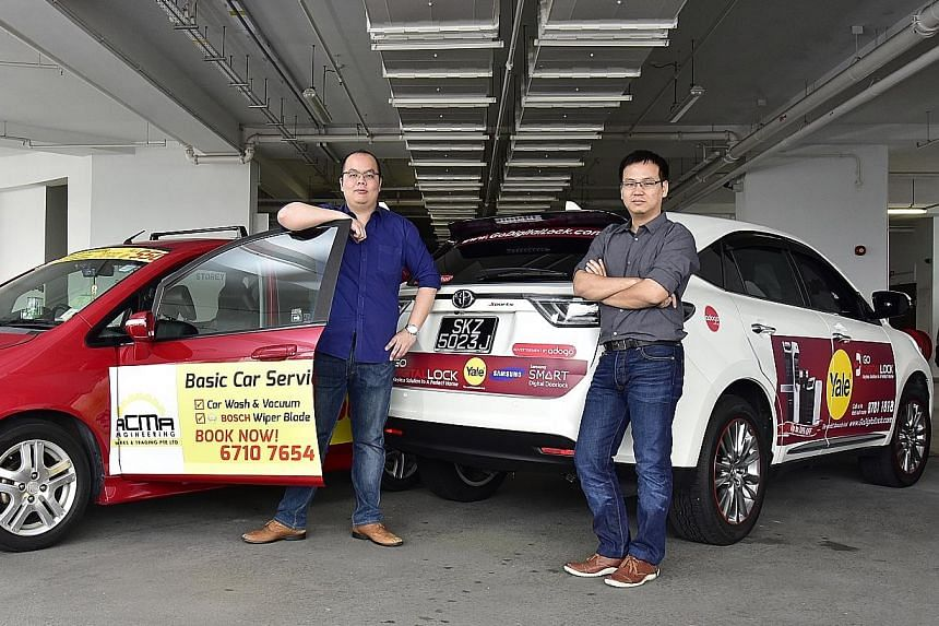 Managing director Max Lin (left) and executive director Michael Xu of Adogo, which pays drivers to carry ads for its clients on their cars. But not all are open to the idea - when ST polled 10 car owners, eight rejected the idea, one was neutral and