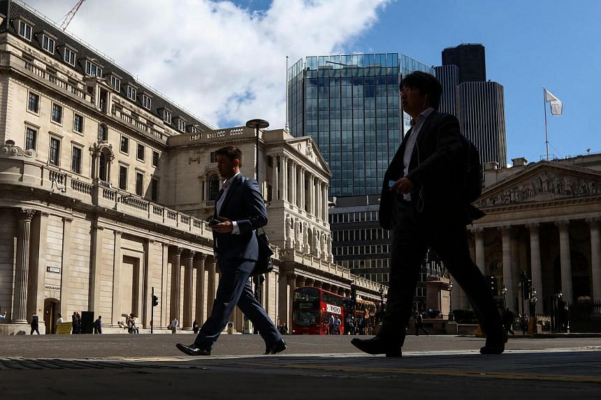 Pedestrians walk past the Bank of England in London, UK, on July 14.