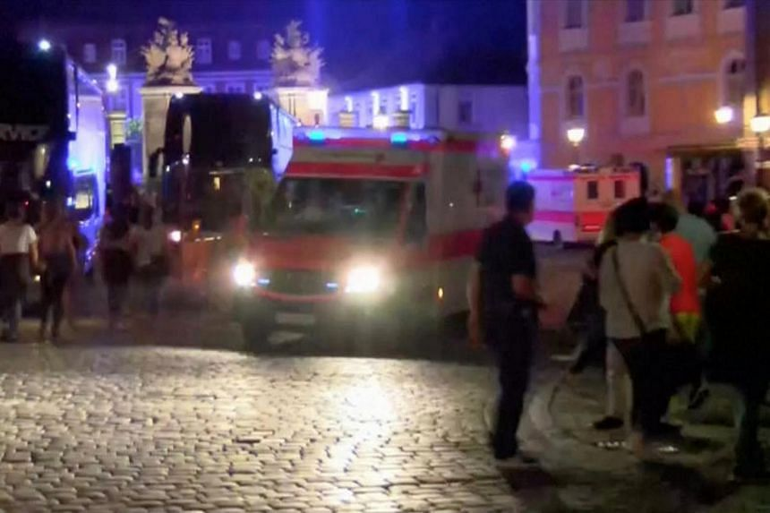 An ambulance leaves as people vacate the square following an explosion in Ansbach, near Nuremberg, July 25, in this still image taken from video.