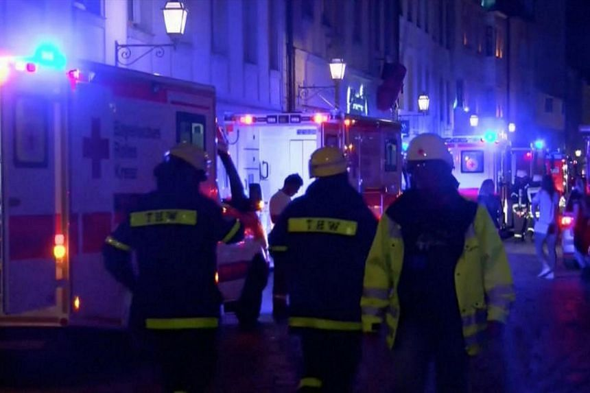 Emergency workers and vehicles are seen following an explosion in Ansbach, near Nuremberg, July 25, in this still image taken from video.