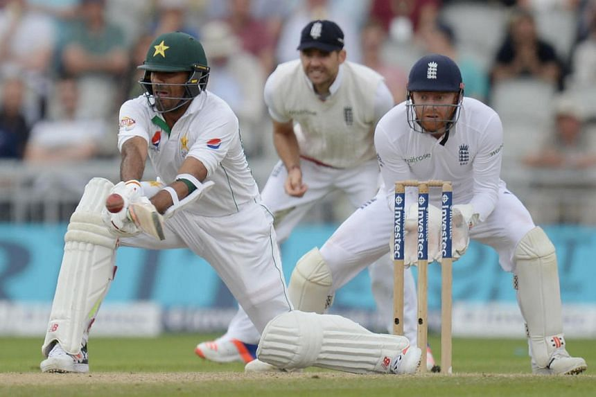 England's Jonathan Bairstow (right) looks on as Pakistan's Wahab Riaz plays a shot on the third day of the second Test cricket match between England and Pakistan on July 24.