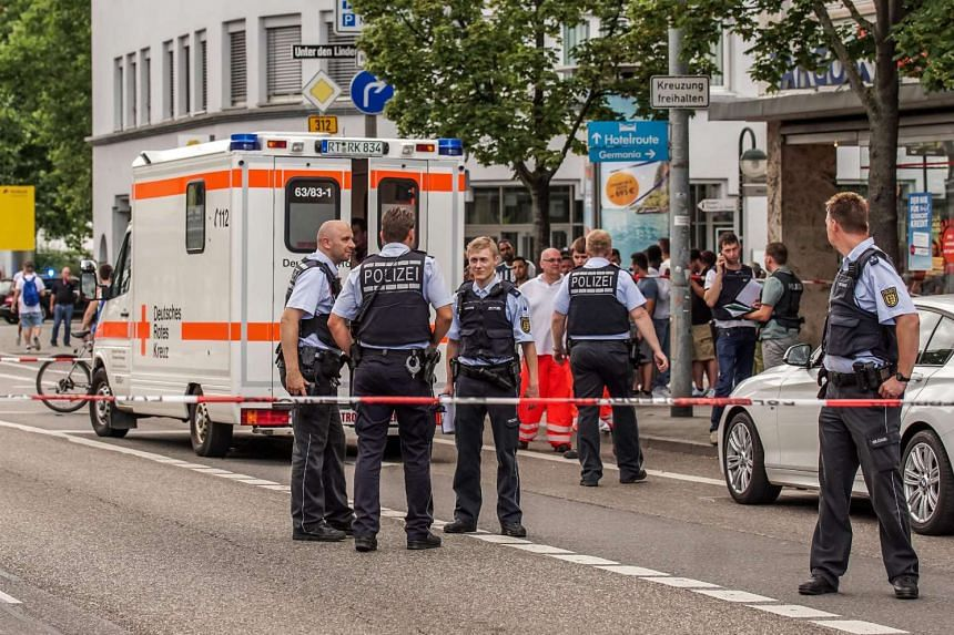 German police at a fastfood restaurant on Sunday (July 24) where a Syrian asylum-seeker killed a woman and injured two people with a machete.
