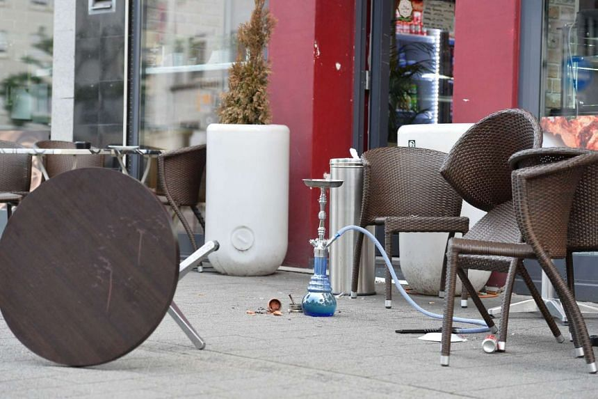 Upturned chairs and a table at a fastfood restaurant in Reutlingen, Germany where a Syrian asylum-seeker killed a woman and injured two people with a machete.