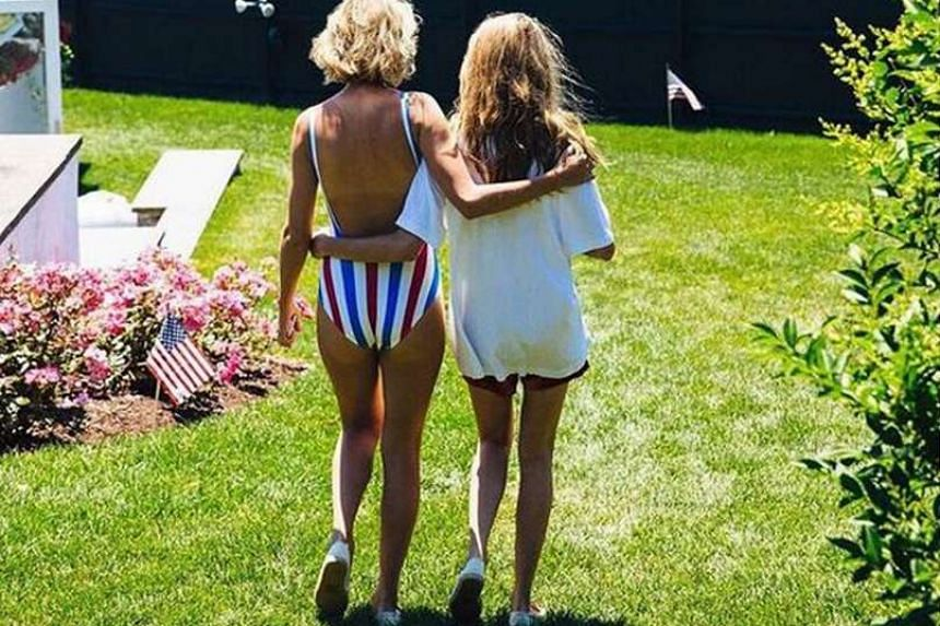 Taylor Swift (above left) in a photo she posted on Instagram of her and a friend on her High Watch lawn.