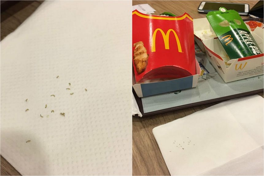 Pictures showing what appear to be white worms in the packaging of a Filet-O-Fish sandwich.