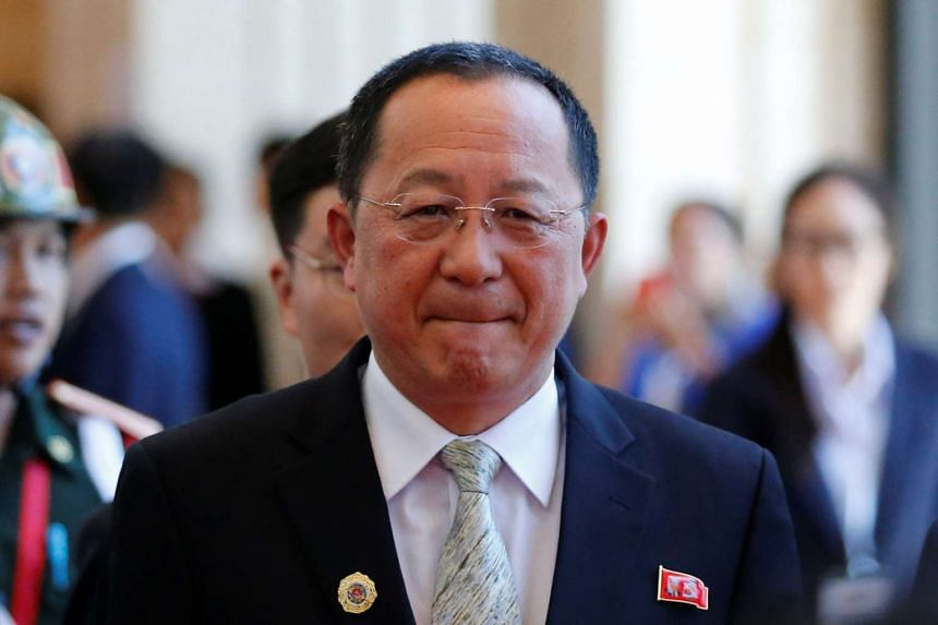 North Korea's Foreign Minister Ri Yong Ho leaves a bilateral meeting with his China counterpart Wang Yi, in Vientiane, on July 25, 2016.