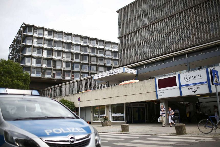 A police car is parked in front of the university clinic in Steglitz, on July 26, 2016, after a doctor had been shot at and the gunman had killed himself.