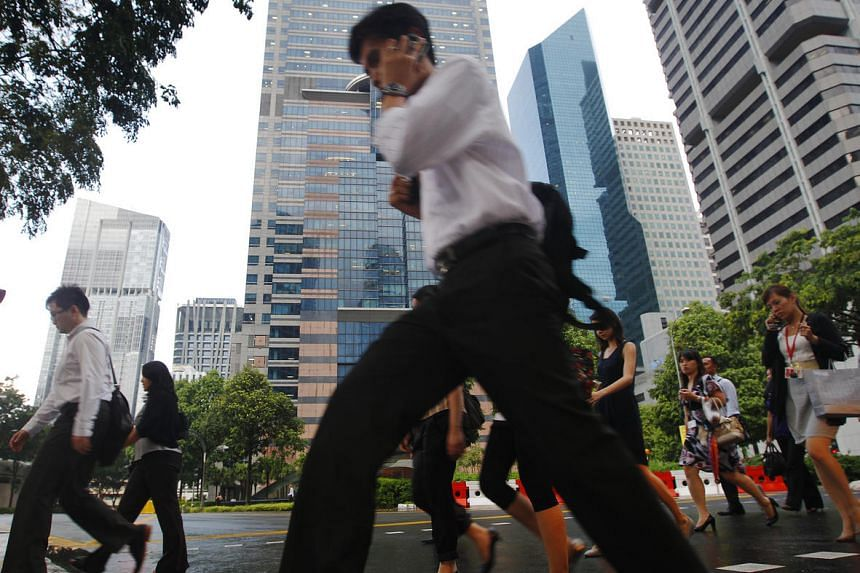 Office workers seen at Singapore's central business district in 2011.