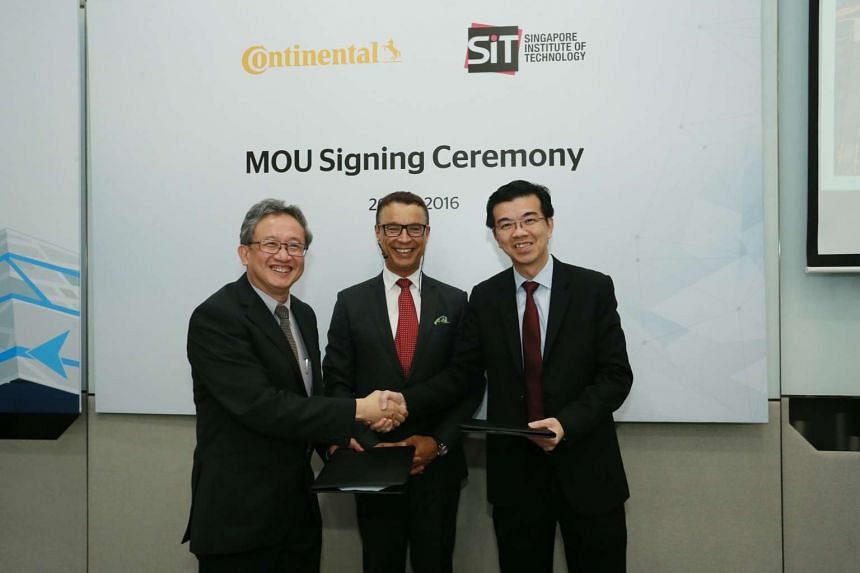 (From left) Prof Loh Han Tong, academic deputy president and provost for SIT, Mr Ralf Lenninger, senior vice-president of Interior Electronics Solution, Continental and Mr Lo Kien Foh, managing director of Continental Automotive Singapore.