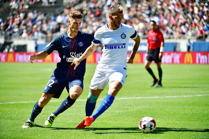 Inter Milan's Caner Erkin (right) keeps the ball away from Paris Saint-Germain's Thomas Meaner (left) during their International Champions Cup football match at Autzen Stadium in Eugene, Oregon.
