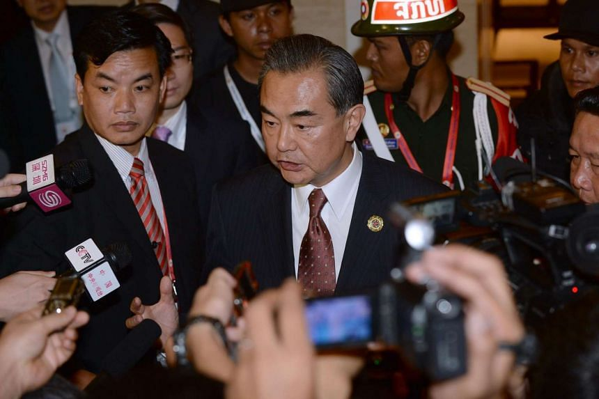 Chinese Foreign Minister Wang Yi (center) speaks to reporters after he met with US State Secretary John Kerry (not pictured) on the sideline of the Asean annual ministerial meeting and the Regional Security Forum in Vientiane on July 25.