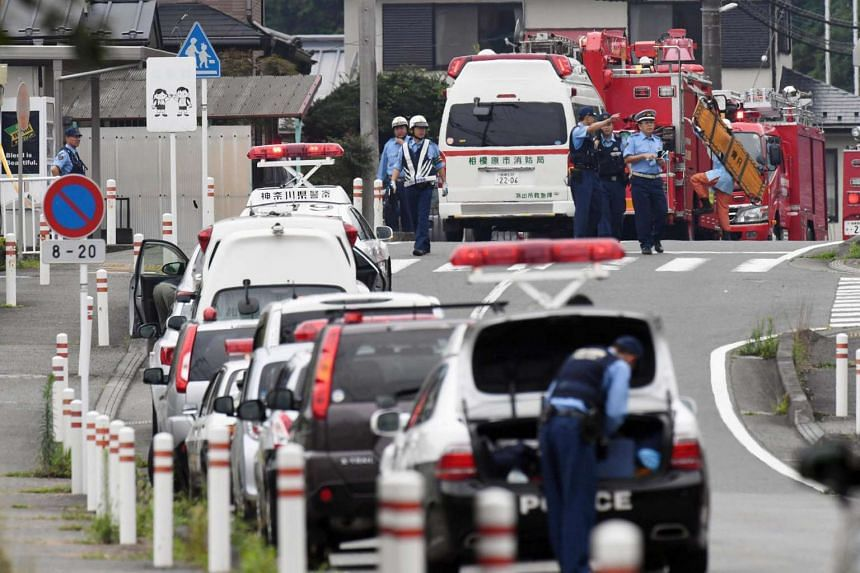 Police officers near a facility for the disabled in Sagamihara, where at least 19 people were killed and more than 40 wounded by a knife-wielding man on July 26.