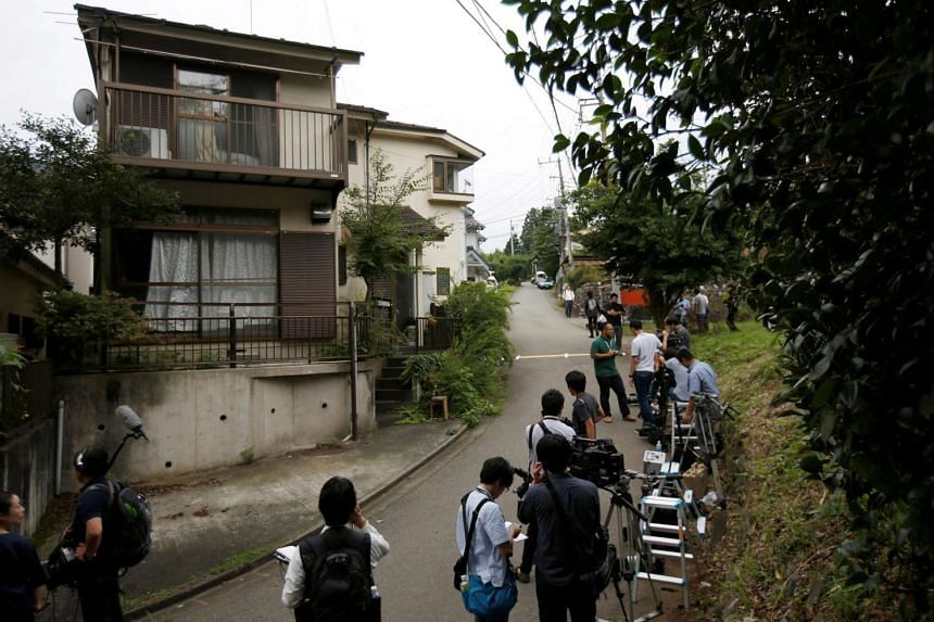 Media gather in front of the home of a man who went on a deadly attack at a facility for the disabled, near the facility in Sagamihara, Kanagawa prefecture, Japan, July 26.