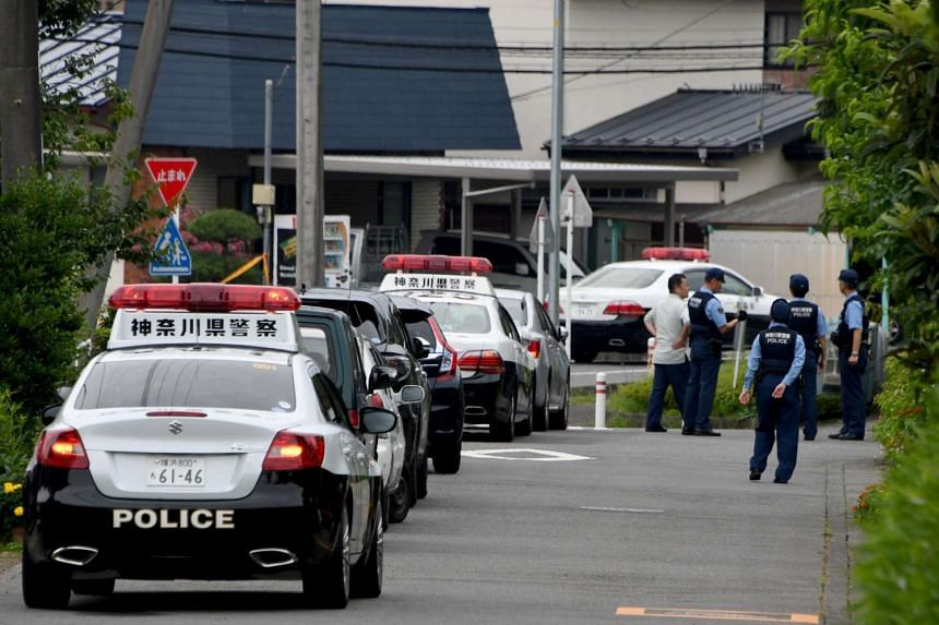 Police officers stand guard near the Tsukui Yamayuri En care centre where a knife-wielding man went on a rampage in the city of Sagamihara, Japan.