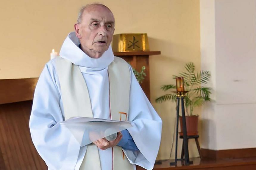 Murdered priest Jacques Hamel celebrating a mass on June 11, 2016, in a photo from the church's website.