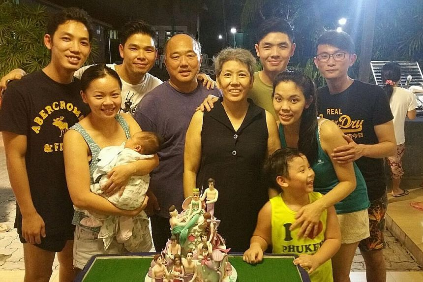 Madam Seow (centre) with family members at the gathering, including (from left) second son Calvin; his wife, Ms Peng Xueyun (with their baby Amelia); eldest son Lionel; Madam Seow's husband, Mr William Peh; youngest son Alvin; and daughter Patricia,