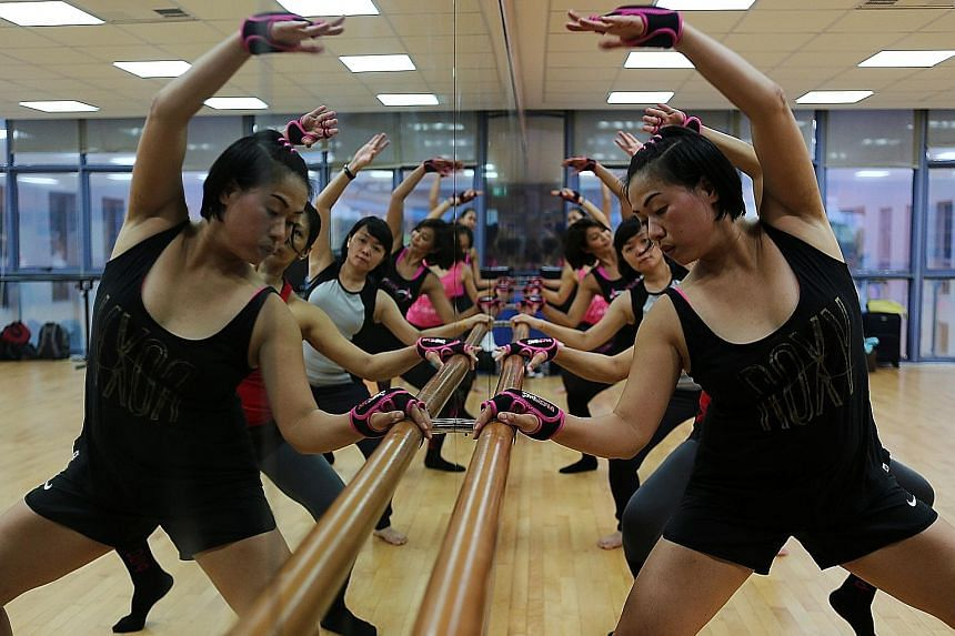 In Piloxing Barre, participants engage more of their muscles by using the barre to bend lower or raise their legs higher.
