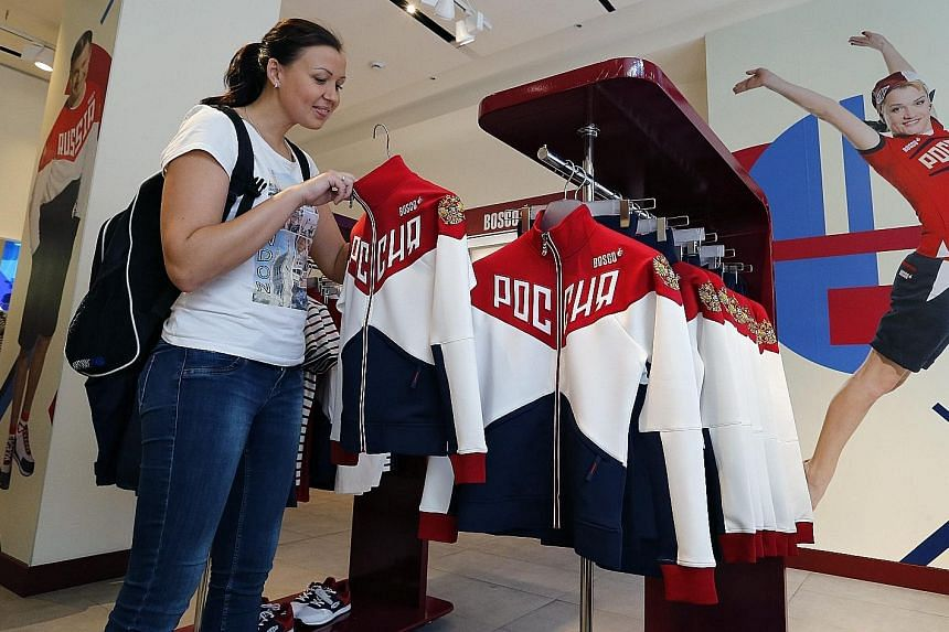 A member of the Russian women's handball team checks out uniforms at the Moscow equipment centre of the Russian Olympic Committee last week, before the IOC decided against imposing a blanket ban on all Russian athletes.