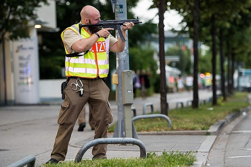 A policeman securing an area after a shooting spree at a shopping centre in Munich last Friday.