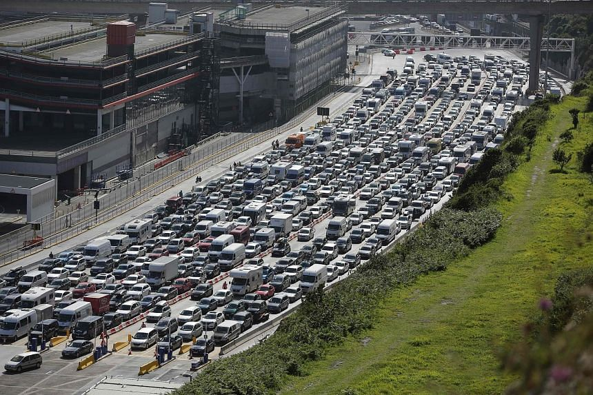 Vehicles waiting for hours to enter the port of Dover on Sunday. British border officials had to be drafted in to help their French colleagues.