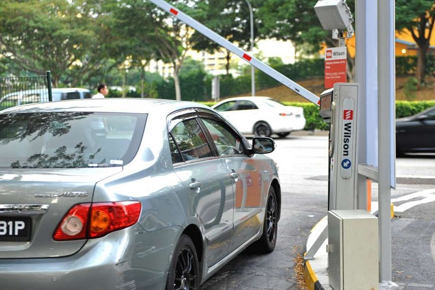 A car passing through an electronic parking system gantry at a carpark in Toa Payoh.