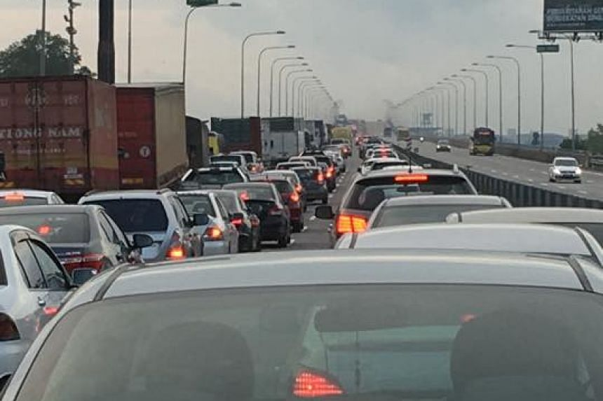 """Facebook user Titi Rawan shared a picture at 7.45am of the traffic standstill, which she said """"begins even before the crossing bridge to the checkpoint""""."""