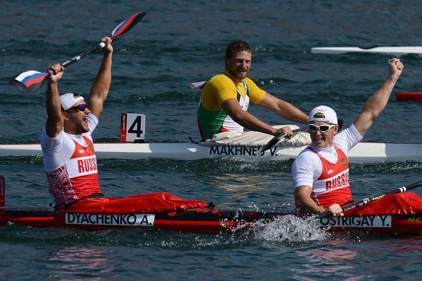 Russia's Alexander Dyachenko (left) celebrates after winning the gold medal in the kayak double 200m men's final A at the London 2012 Olympic Games.