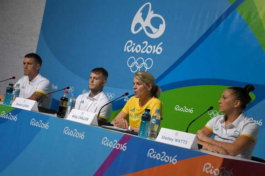 The Chef de Mission for Australia at the 2016 Rio Olympic Games, Kitty Chiller (center), with athletes Jason Whateley (left), Daniel Lewis (second, left) and Shelley Watts (right) at a press conference on July 25.