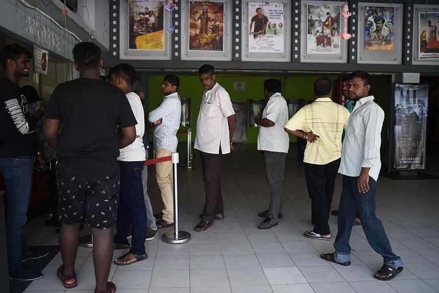 People queuing up to buy tickets for the Tamil film Kabali at a cinema in Kuala Lumpur.