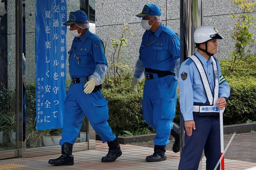 Police officers investigating at the facility for the disabled in Sagamihara, Japan, where a deadly attack by a knife-wielding man took place on July 26.