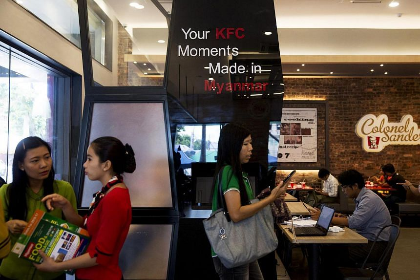 Customers in a KFC restaurant, operated by Yum! Brands Inc KFC and Yoma Strategic Holdings, in Yangon in October 2015.