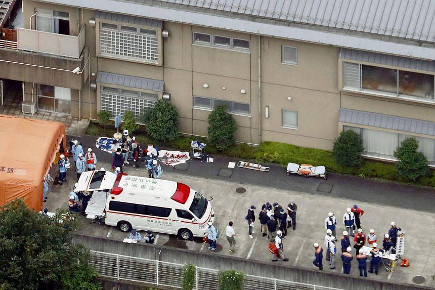 Police officers and rescue workers at a facility for the disabled in Sagamihara, where at least 19 people were killed and as many as 20 wounded by a knife-wielding man.