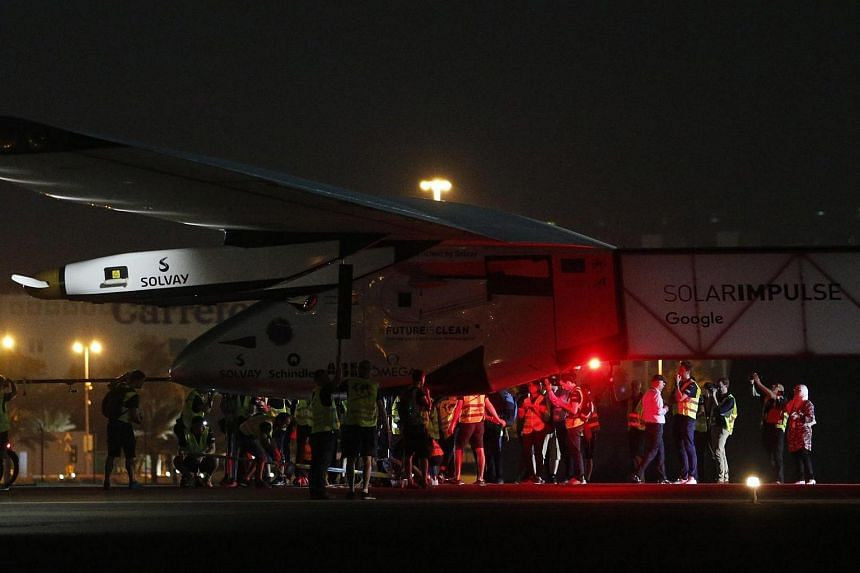 Solar Impulse 2, the solar powered plane, arrives at Al Batin Airport in Abu Dabi to complete its world tour flight on July 26, in the United Arab Emirates.