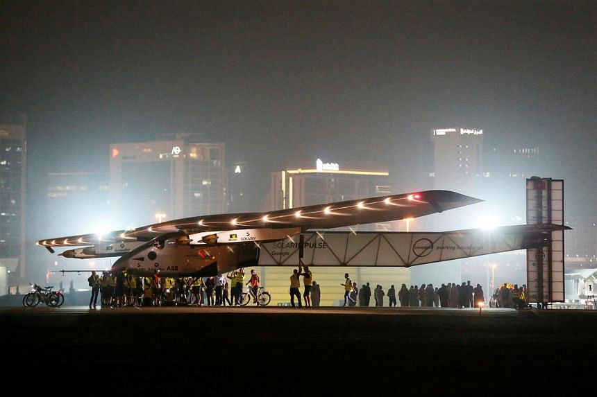 Solar Impulse 2, a solar powered plane, arrives at an airport in Abu Dhabi, United Arab Emirates on July 26.