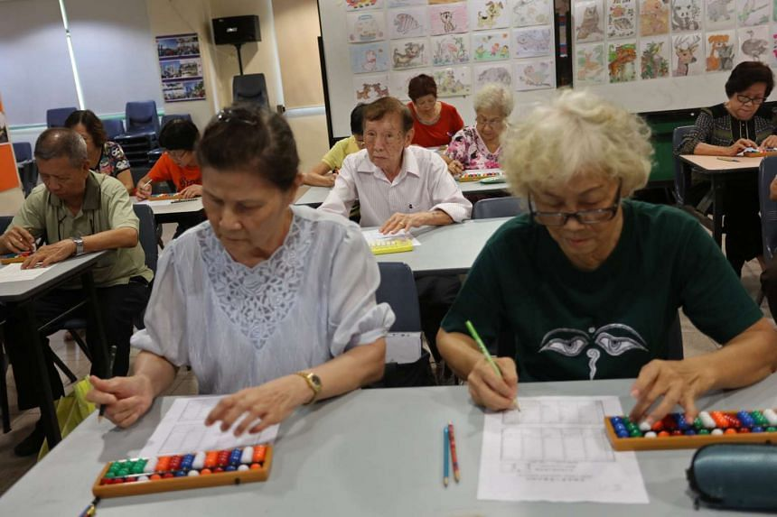 Some of the 17 senior citizens taking the abacus grading exam set by the Taiwan Chamber of Commerce. Participants who sat the exam at Geylang Serai Community Club yesterday had to get seven out of 10 sums correct to be awarded an internationally-reco